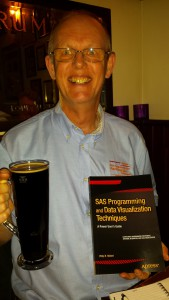 Happiness: my new book, a beer and my advertising shirt at the book launch in Cambridge